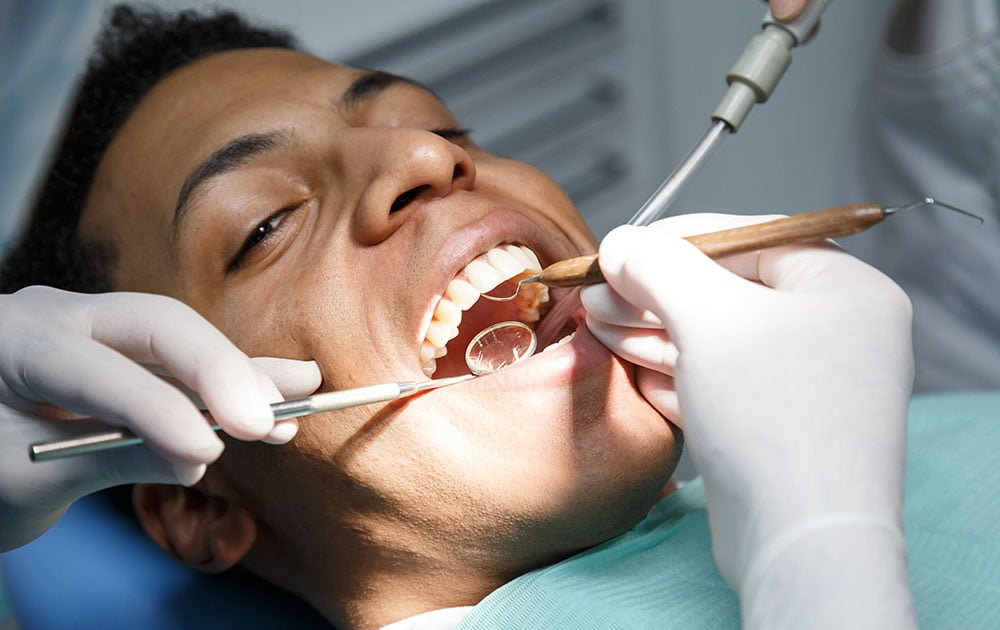 Example of a checkup and cleaning provided by Dentistry at the Grove