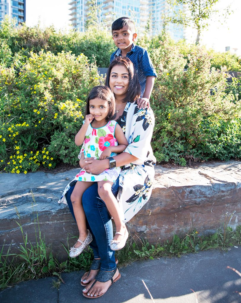 Dr. Niromi Fernando of Dentistry at the Grove with her two children in Burlington, Ontario